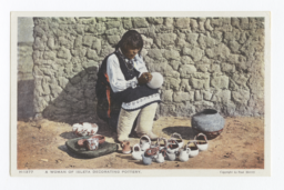 Woman of Isleta Decorating Pottery