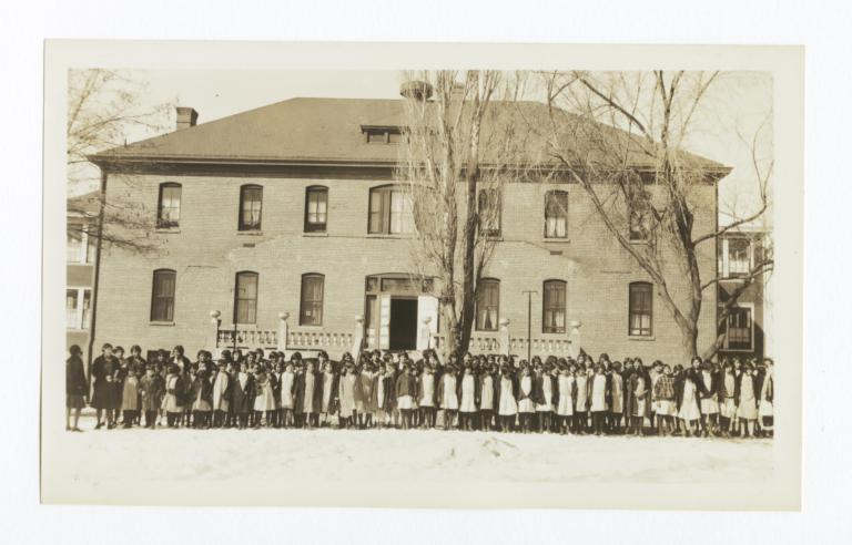 Group of Students Standing in front of a Building on Campus
