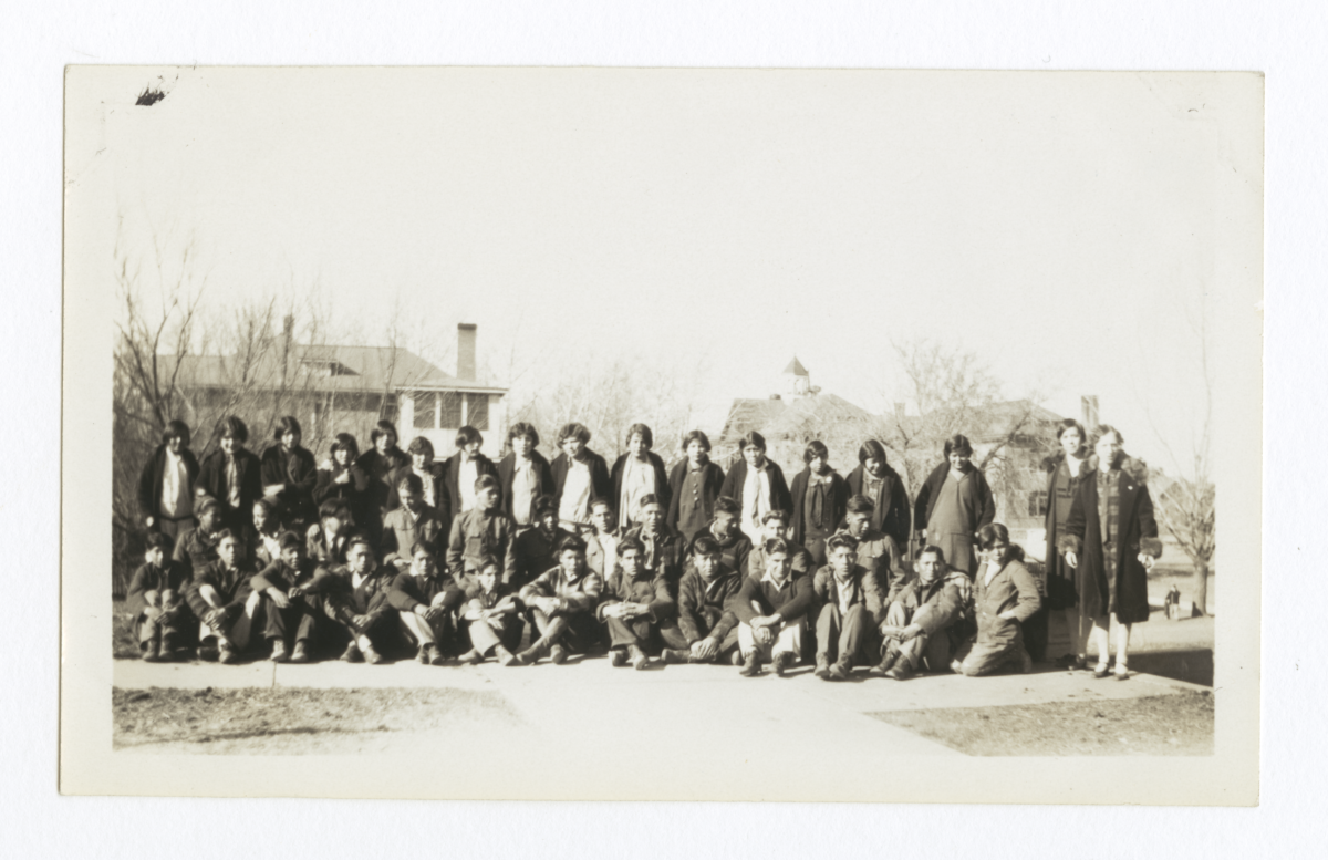 Large Group of Unidentified People in front of Buildings