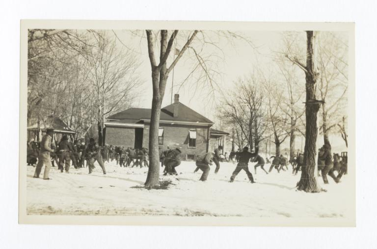 Large Group Snow Ball Fight on a Snow Covered Campus
