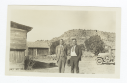 G.E.E. Lindquist and Another Man with a Hat Standing Outside