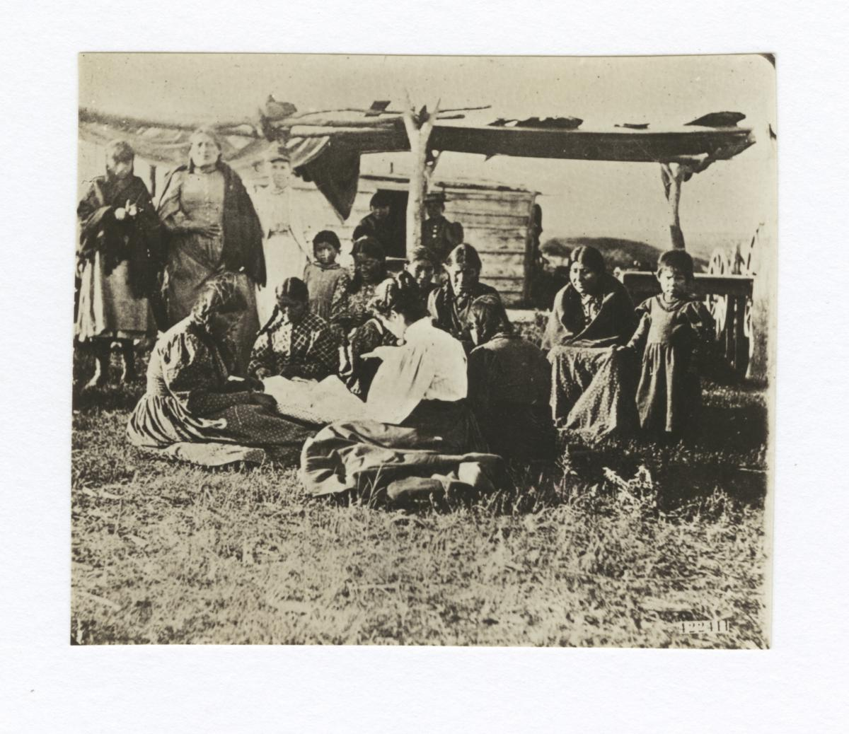 Group of Native American Women and Children Listening to Woman Reading