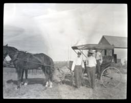 Horse and Buggy with Several People Standing around It