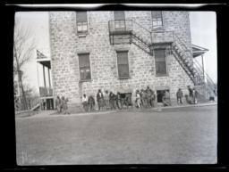 Boys outside of Pawnee School, Oklahoma