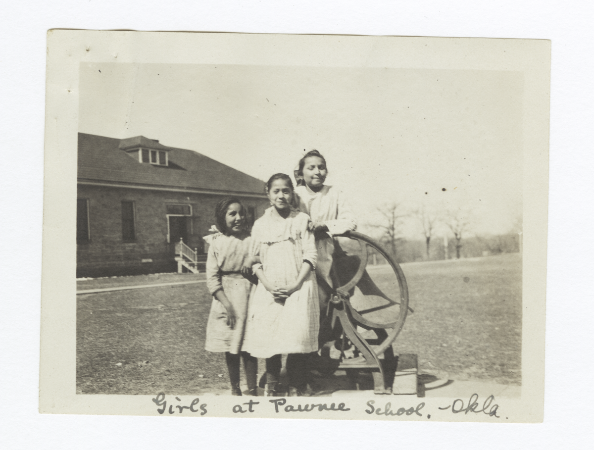 Girls at Pawnee School Posing next to School Bell, Oklahoma