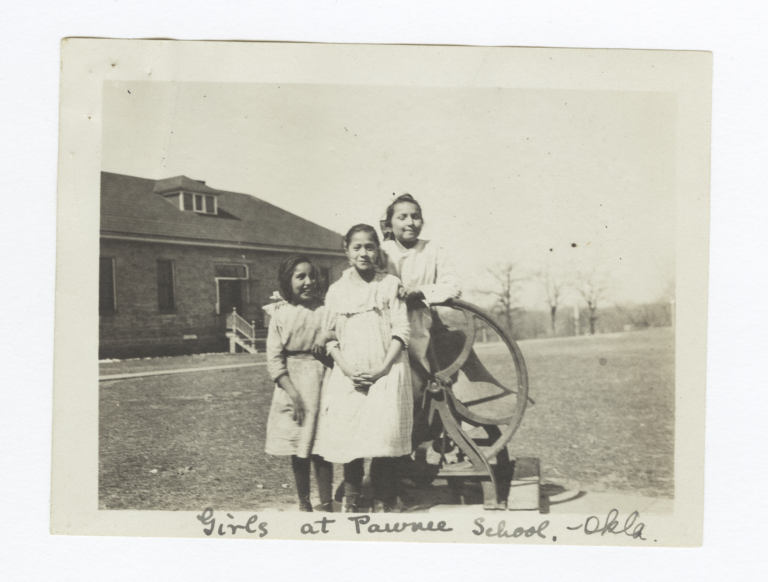 Girls at Pawnee School Posing next to School Bell, Oklahoma