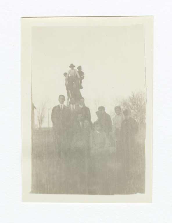 Group of Men Outside Gathered around or on a Slide