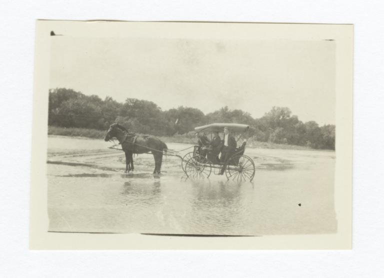 Three Men in Horse and Buggy Crossing a River