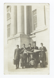 Young Men in Suits Holding Chilocco Indian School and YMCA Pennants