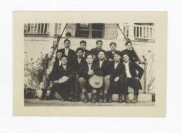 Group of Young Men Sitting on Steps of a Building