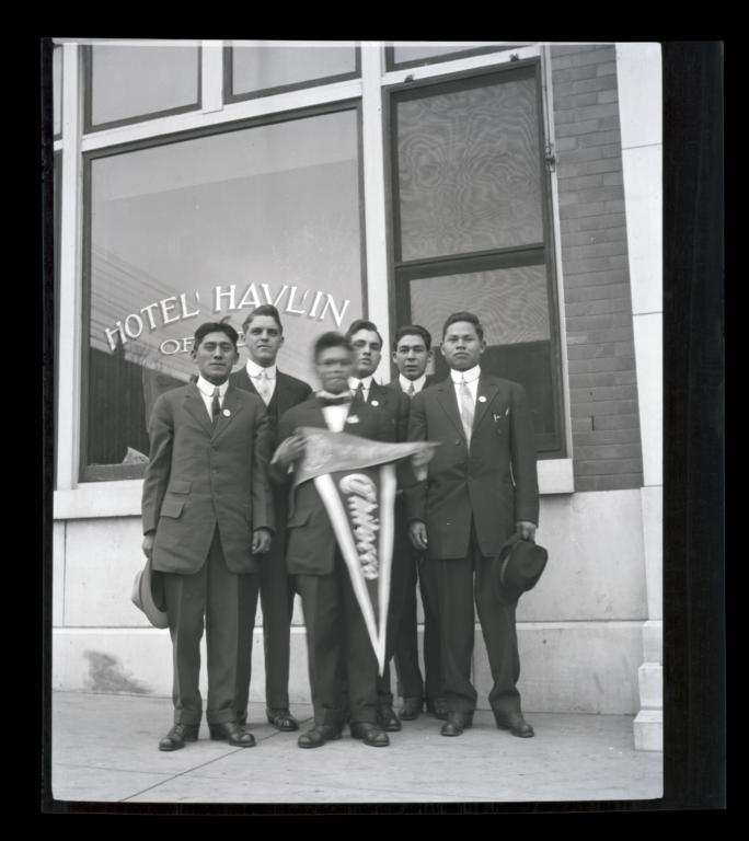 Young Men Holding Chilocco and YMCA Pennants Standing  in front of the Hotel Havlin