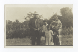 Native American Man, Woman and Young Girl and Boy Standing Outdoors