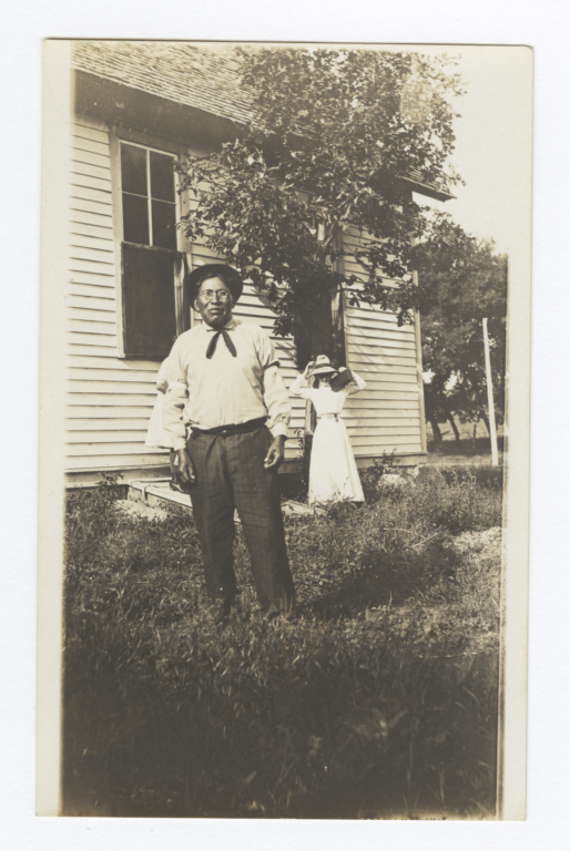 Fort Sill Apache Man and Woman Standing in the Yard of a House