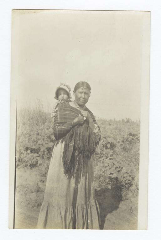 American Indian Woman Carrying a Young Child on Her Back