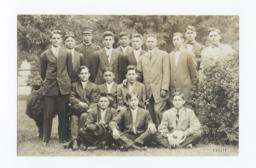 Group of Men Posing between Two Small Shrubs