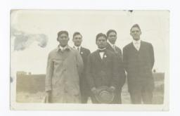 Five Men Wearing Suits and Ties Posed Standing in a Field