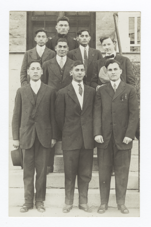 Small Group of Men Standing on Steps Wearing Suits and Ties
