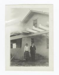 Man and Woman Posing in front of Building, Creek, Oklahoma