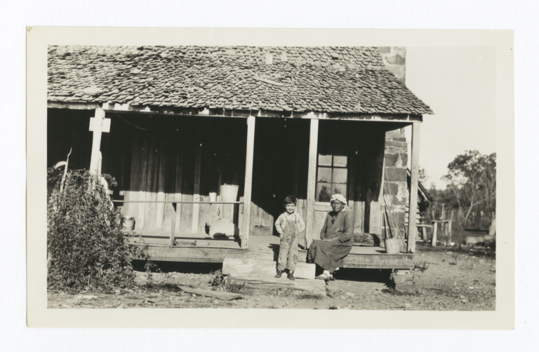 Cherokee Woman and Boy on Porch and Steps, Cherokee County, Oklahoma