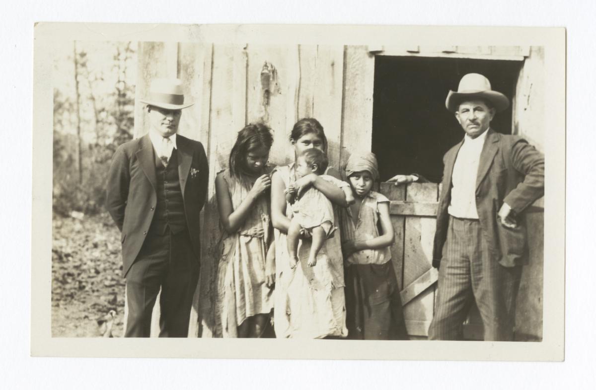 Children of Charlie Crittenden with Superintendent Correll and Interpreter George Gourd