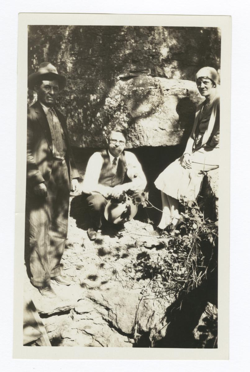 Woman and Two Men in front of an Entrance to a Cave that Was Used by Outlaws to Hide