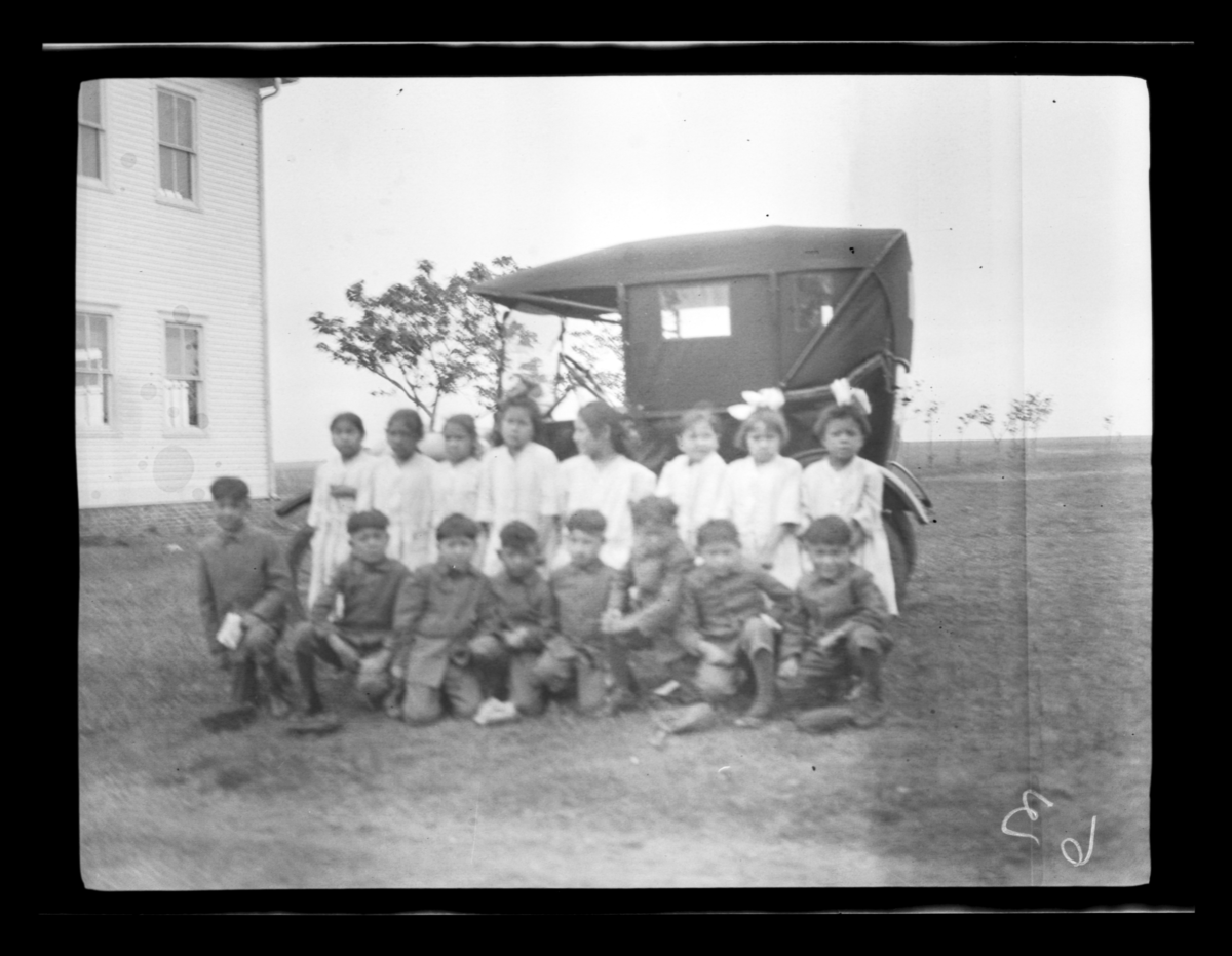 Group Posing in front of Automobile at Cantonment School, Oklahoma