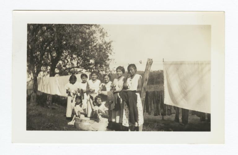 Group of Girls with Irons and Laundry