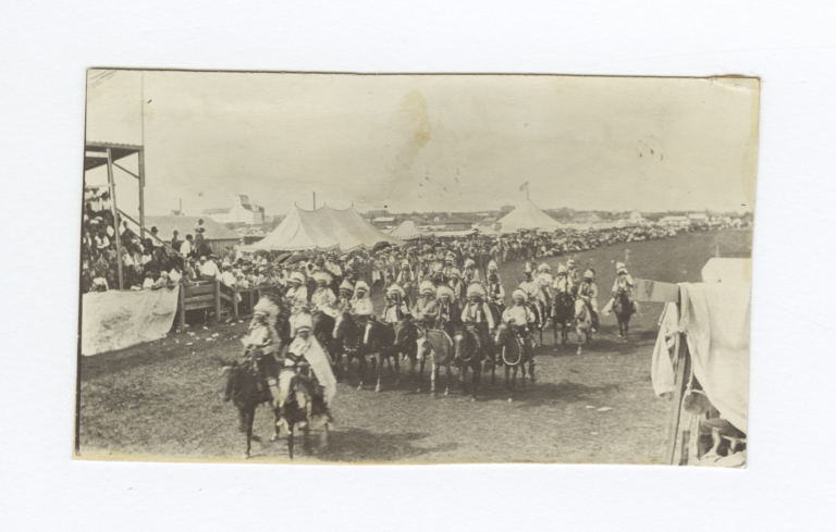 Group of American Indians on Horses Parading in front of Grandstands
