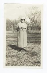 Elderly Woman Standing in a Field