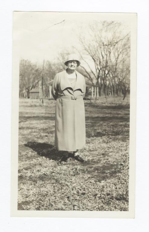 Elderly Woman Standing in a Field