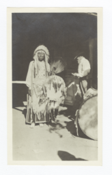 American Indian Man with Drum, Fan, and Headdress