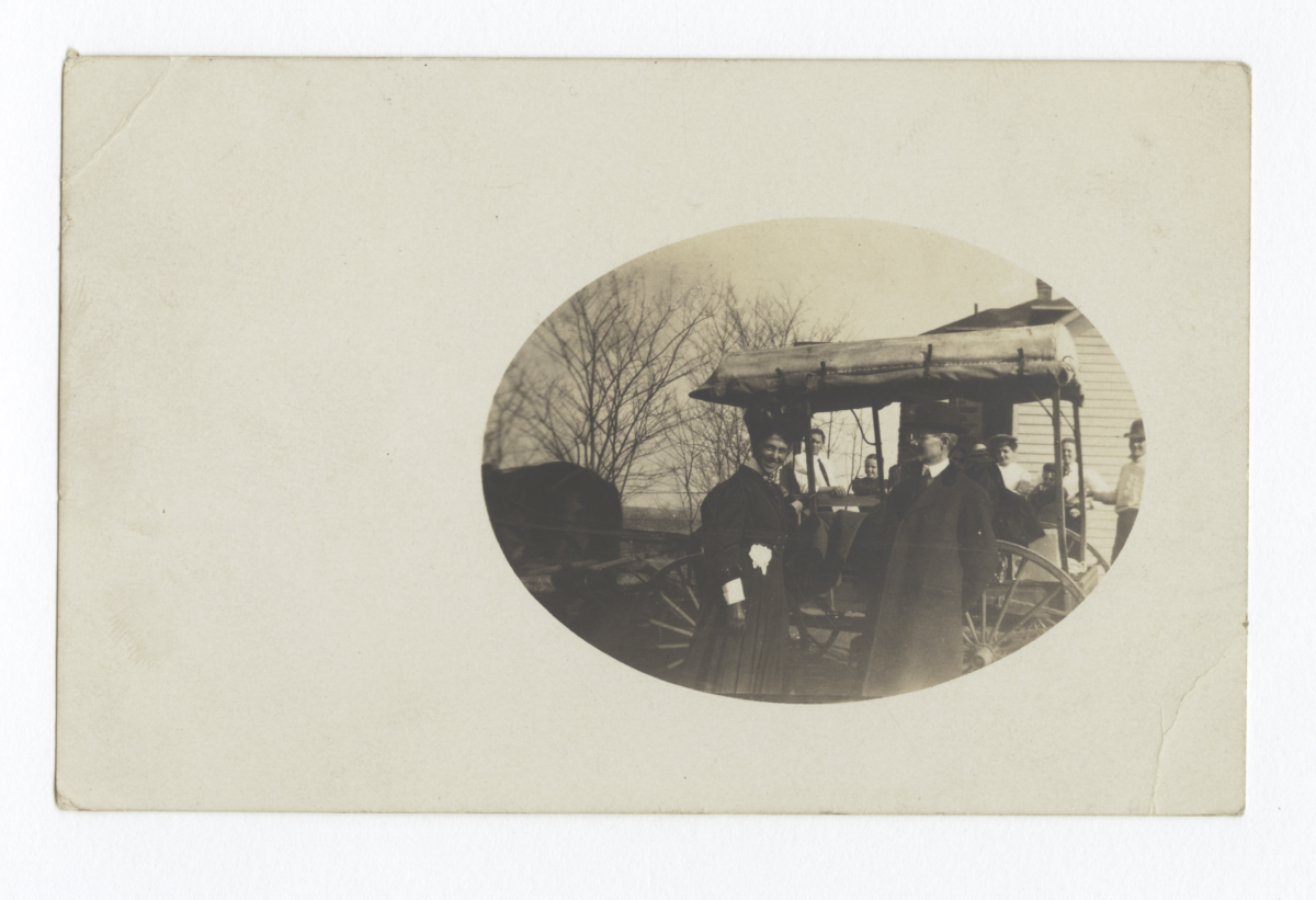 Walter C. and Mary Roe before a Horse-Drawn Carriage and Gathered People