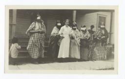 Nurse and American Indian Women with Bandaged Eyes