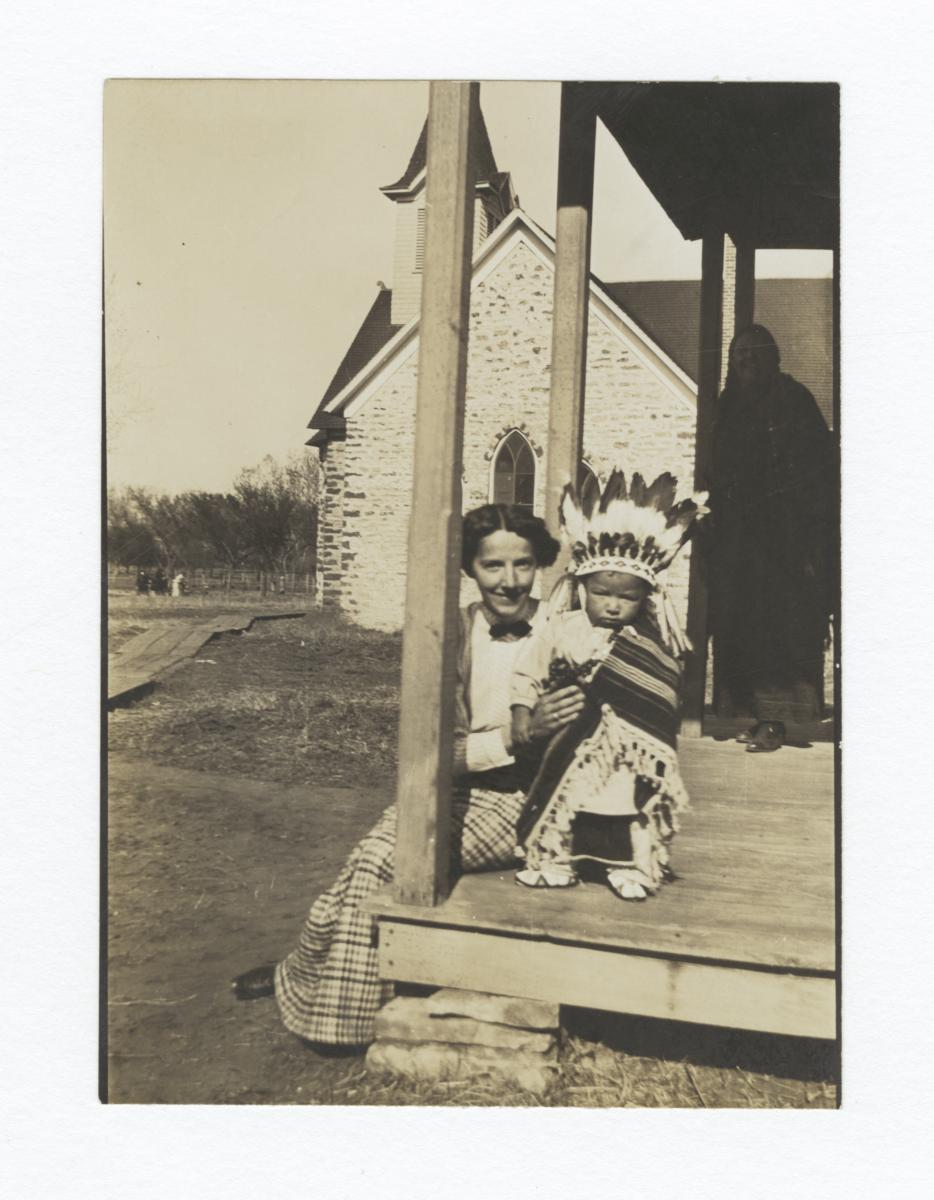 Woman with American Indian Child in Traditional Dress, Mother in Shadows behind