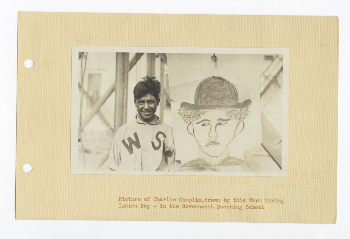 Warm Spring Indian Boy with His Picture of Charlie Chaplin, Oregon