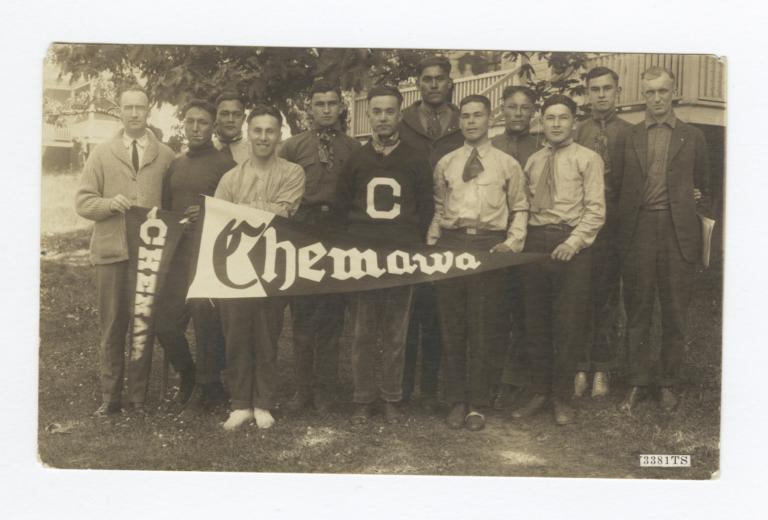 "Group of Men Holding Pennants Reading ""Chemawa"""