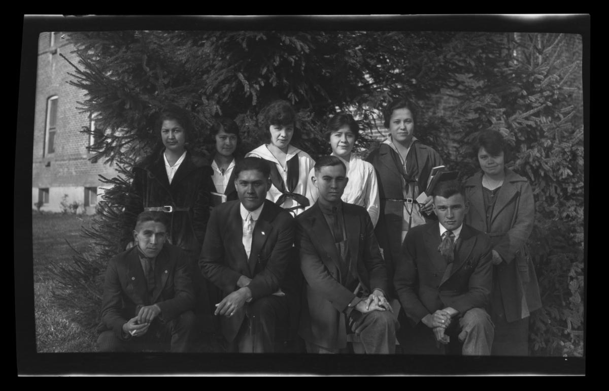 Group of Young People Posing in front of Foliage