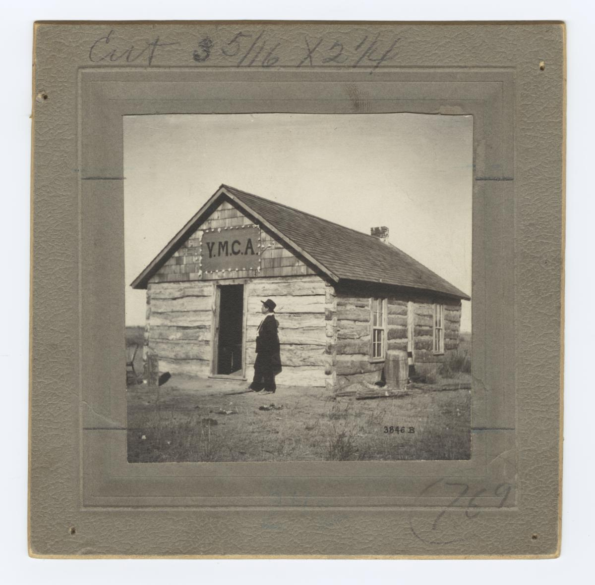 Man Standing in front of the Y.M.C.A. Building on Pine Ridge Reservation, South Dakota