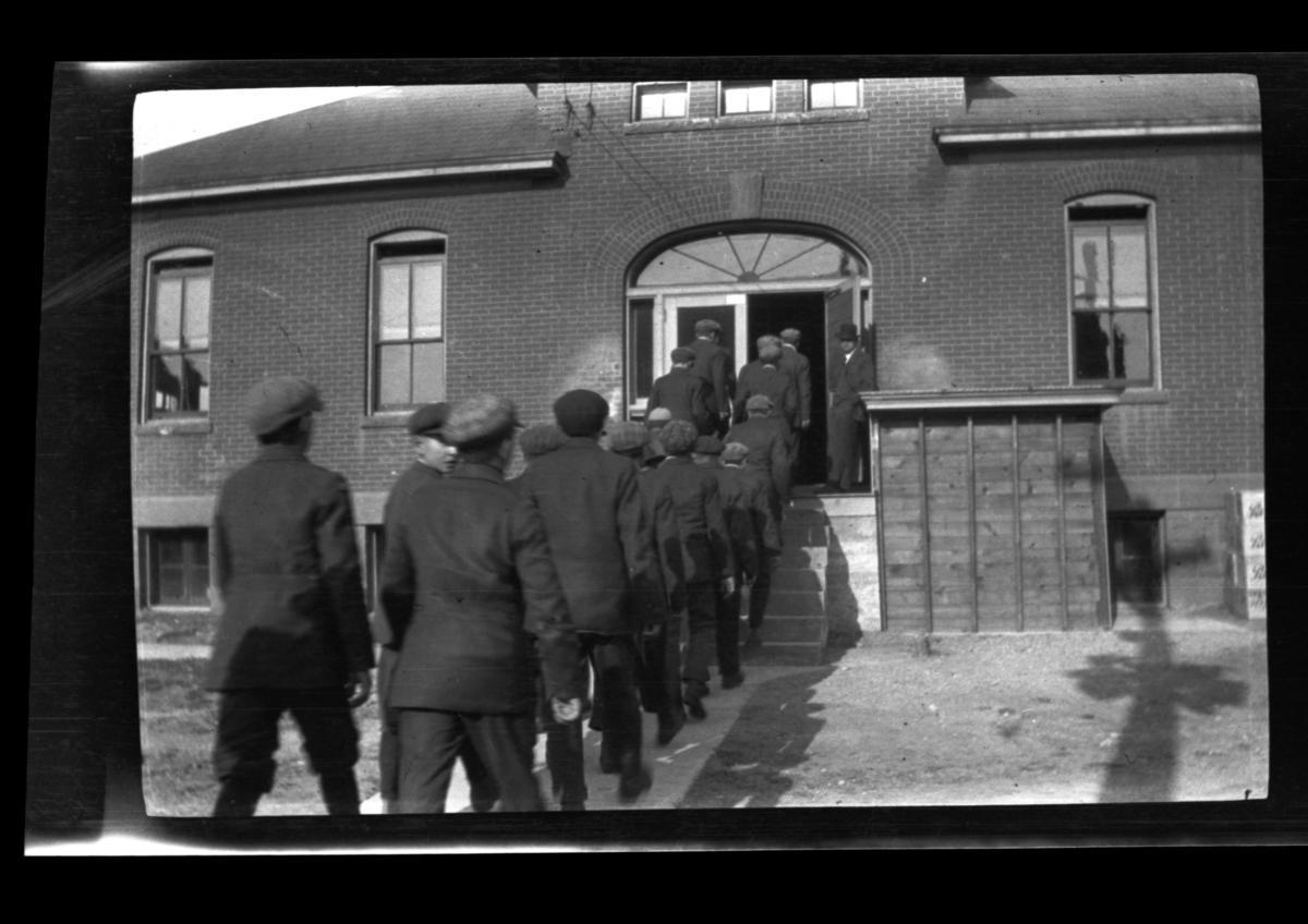 Group of Men Entering a Building, Rapid City, South Dakota