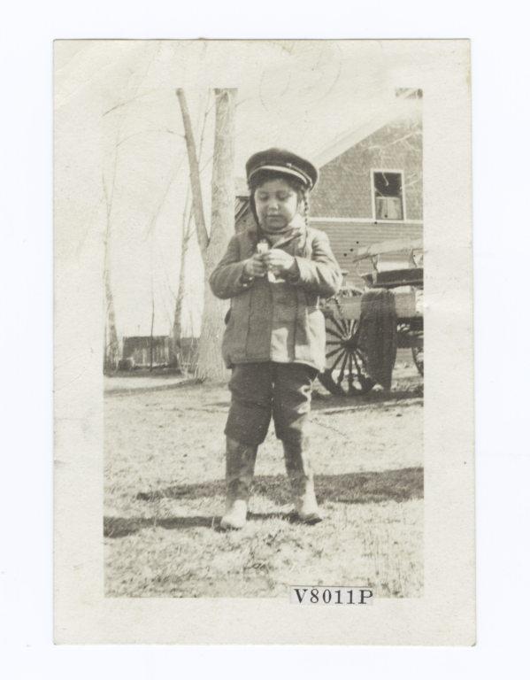 Young Child with Braided Hair under a Hat, and Wearing Cowboy Boots, South Dakota