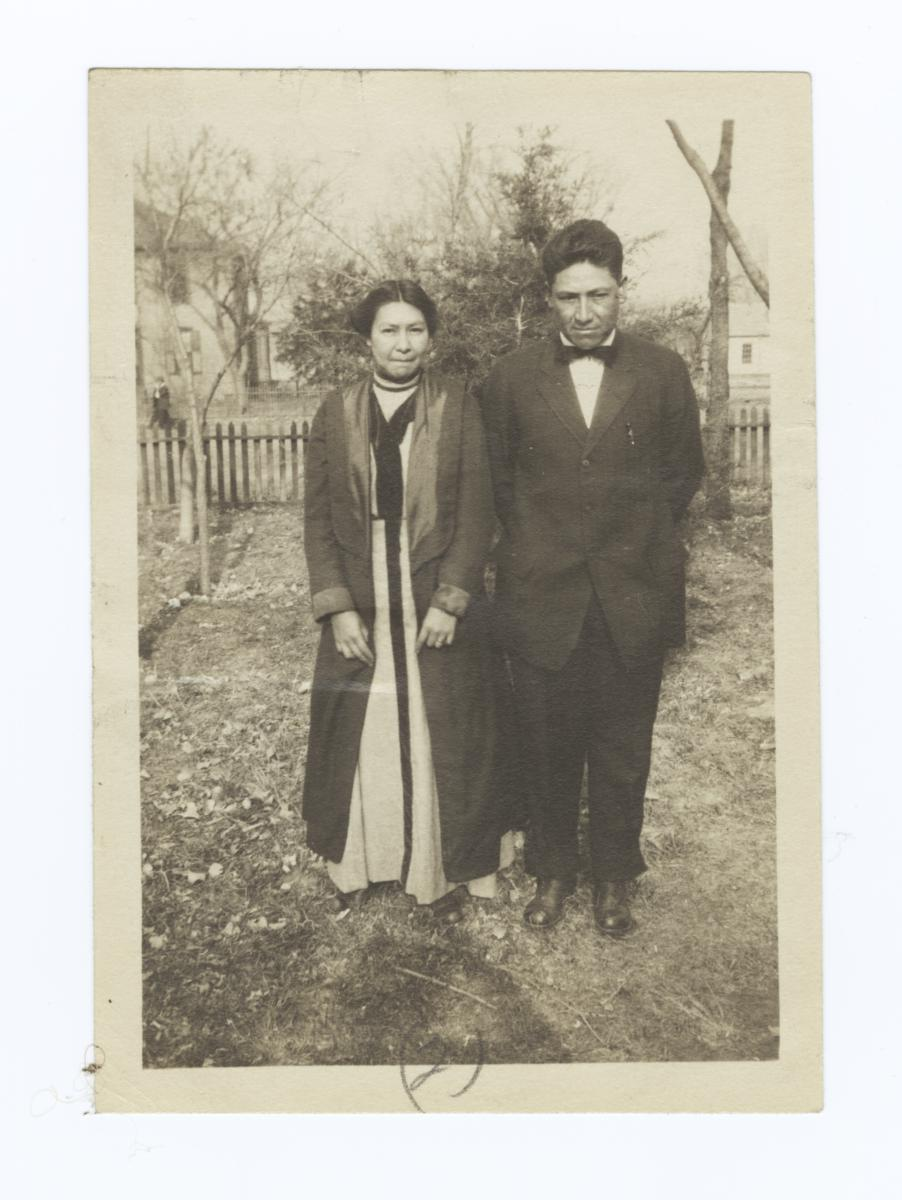 Woman and Man All Dressed up, and Posing in the Yard