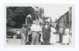 Missionary and Chief Paul Dick Standing together with Canadian Indians in Background, Puget Sound