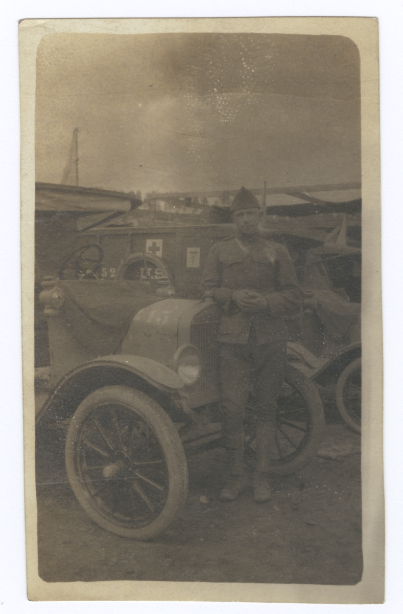 Soldier Posing with a Numbered Vehicle