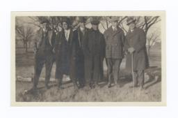 Six Men, Dressed Handsomely, on Path in Fields