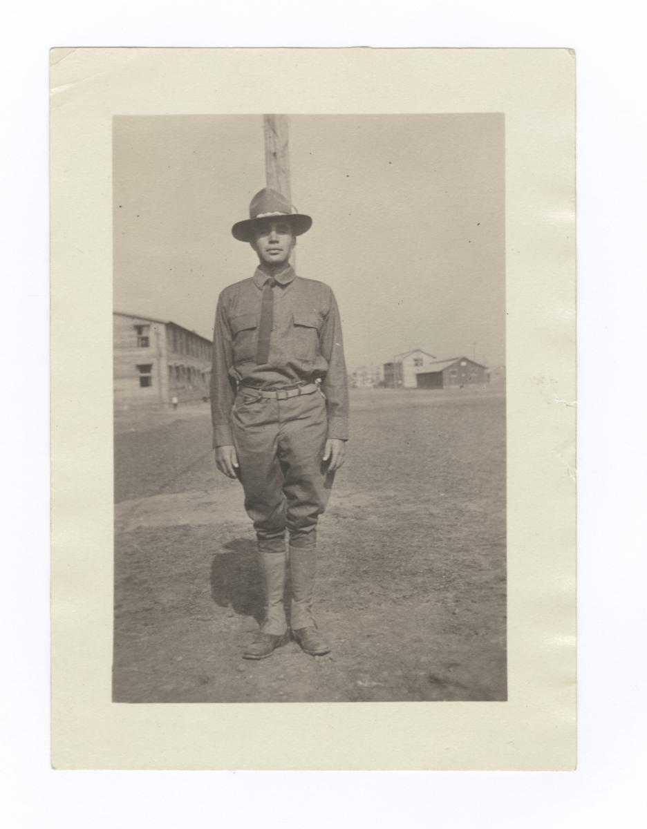 Soldier Standing in front of Flag Pole