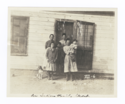 American Indian Family in front of Their House