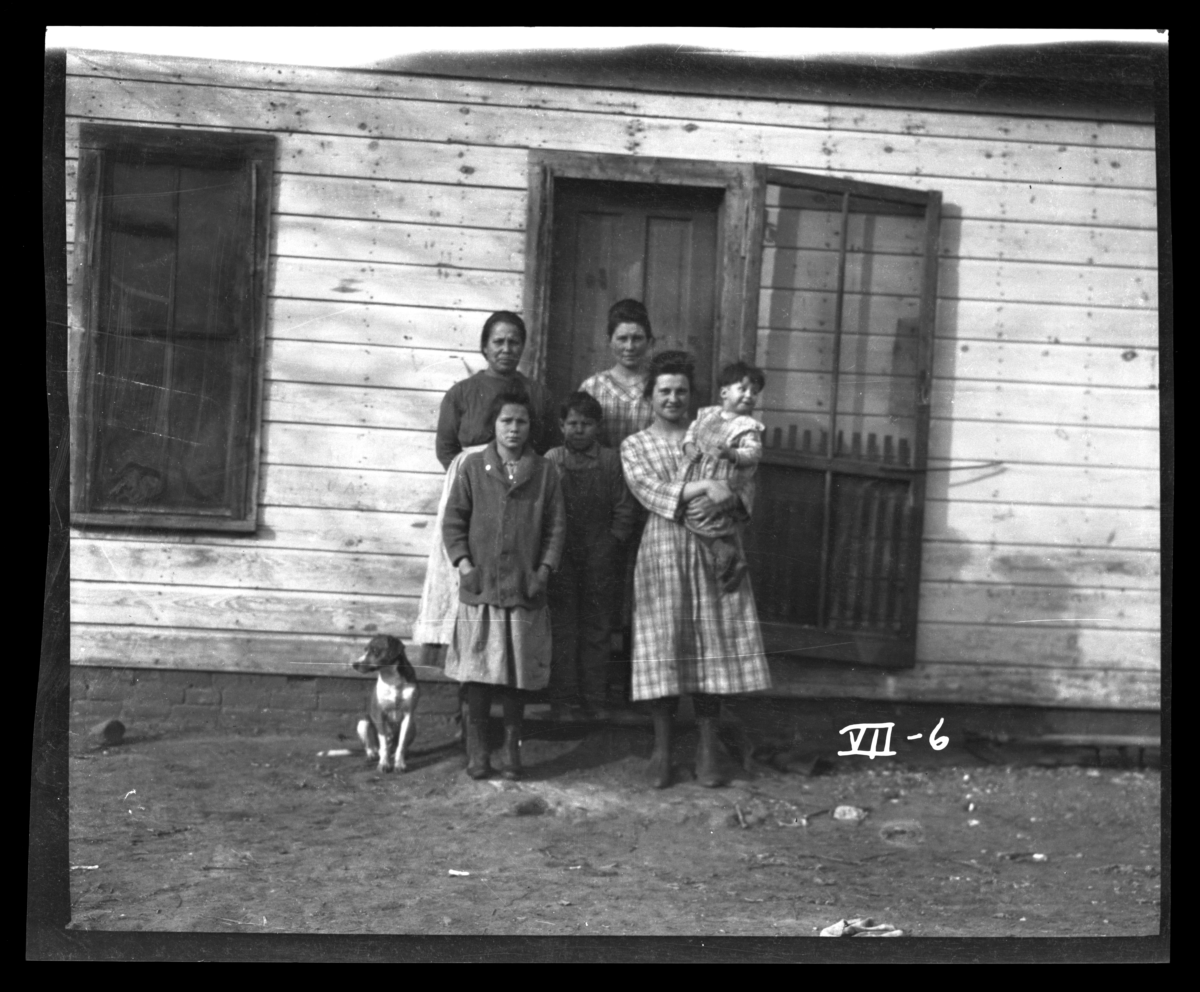 Indian Family in front of Their House