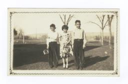 Three Children Posing in Field, Francis, Wilber, and Winona Frazier