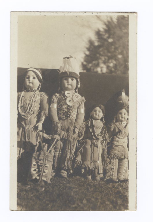 Row of Dolls in Native American Dress