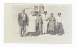 Six Native Americans in front of Adobe House